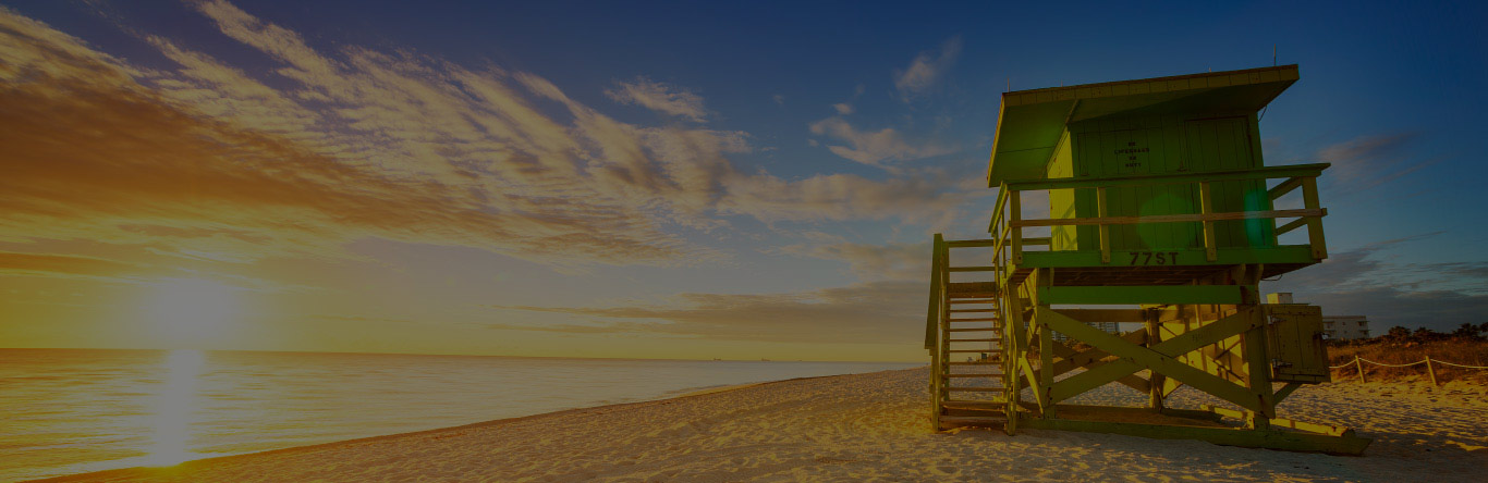 Lifeguard tower on beach at sunrise
