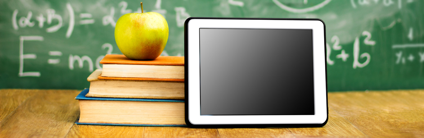 Tablet, apple, and books in a classroom